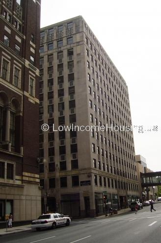 In town apartment building providing 12 by 14 housing in convenient, central location.