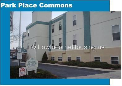 Park Place Commons with dormer windows and large, two story apartments with installed air conditioners