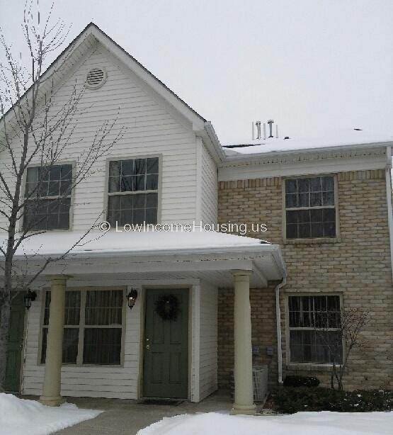 Large, two story housing unit with large, steel window frames.  Ample curbside parking is available.