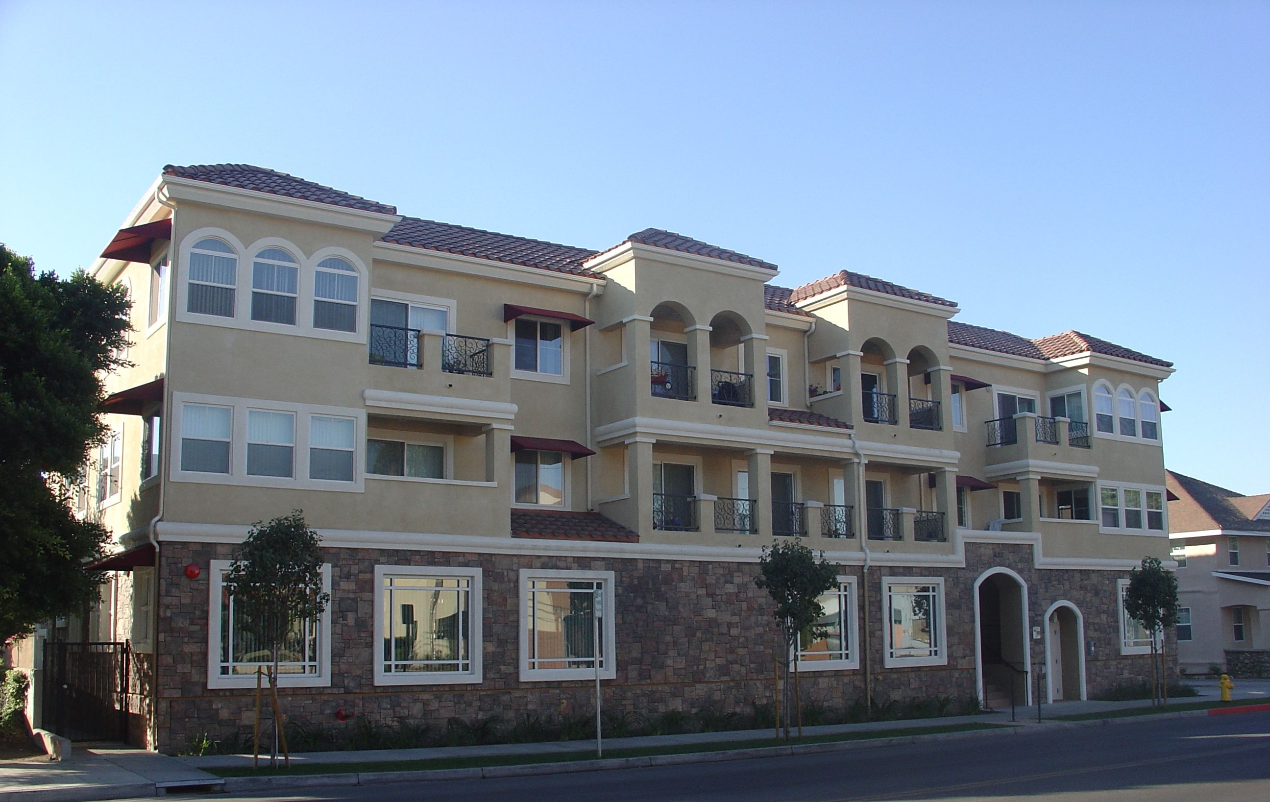 fabulous, large glass windows Second story balconies  with wrought iron balconies and exterior siting spaces.