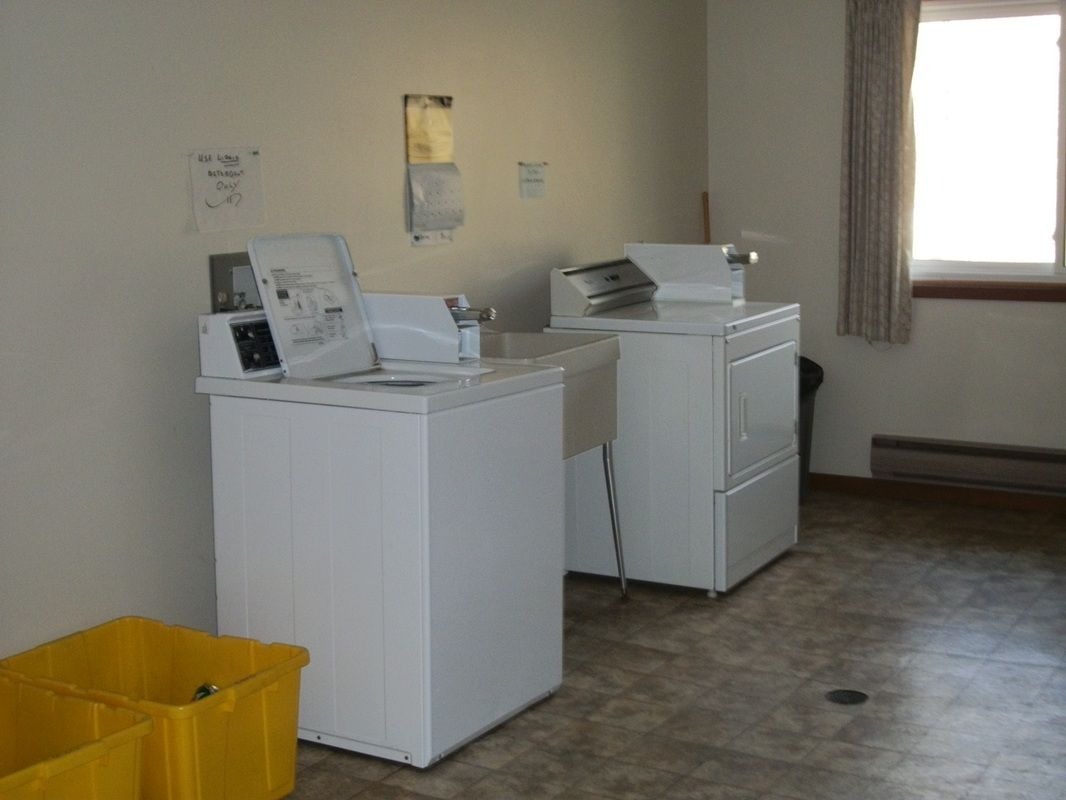 Large capacity, coin operated, washer/dryer equipped with sorting and folding  table