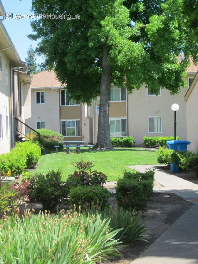 Large, spacious two story housing units with large windows, exterior picnic table, exterior lighting, mature shade trees and attractive setting.