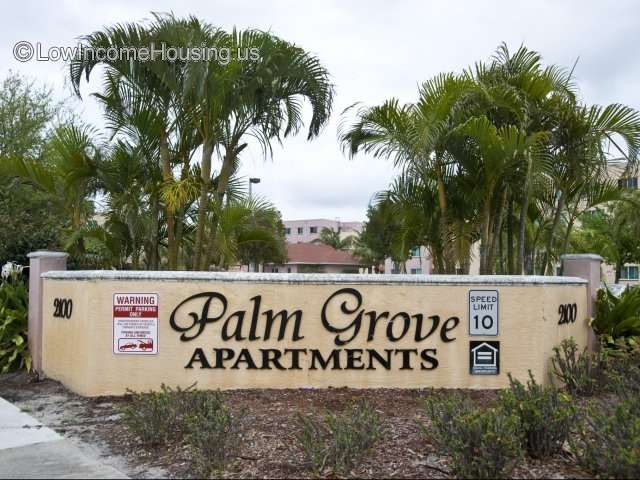 Entrance to Palm Grove Senior Living Apartments ample and spacious foliage