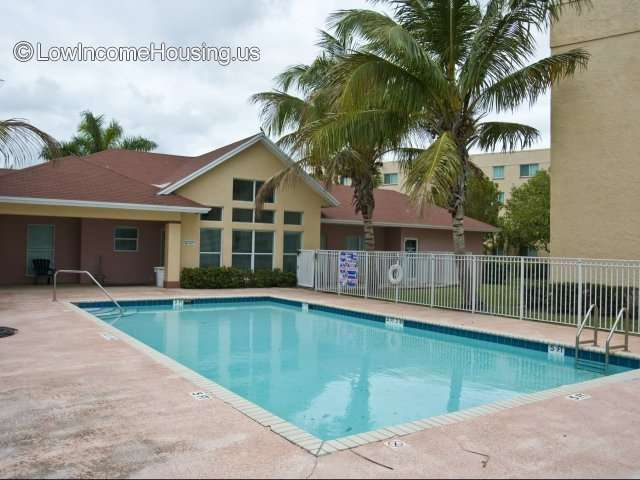 Luxurious fenced-in swimming pool facility  with changing rooms on-site.