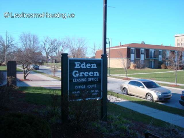Eden Green Leasing provides access to large apartment spaces containing two story red brick apartment construction and large dormer windows.