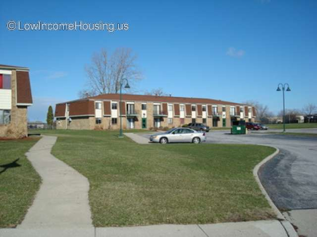 Multi Unit red brick two story apartments with 14 floor to built in ceiling window units.