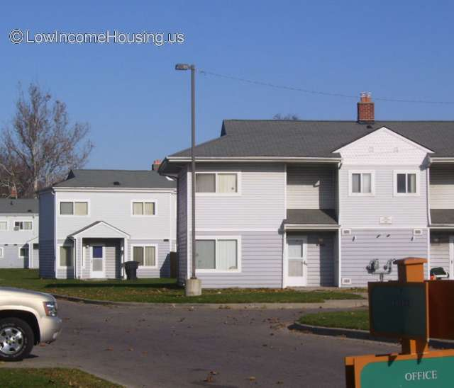 White clapboard housing units with 6 bedrooms and easy access to street.